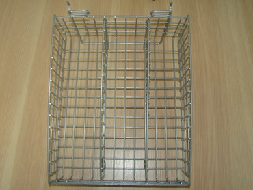 A three-piece basket for attaching in a spacewall or perforation