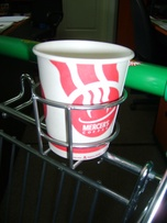 Cup holder for a shop trolley