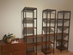 A steel bookcase with wooden shelves